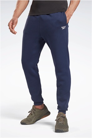 Reebok ανδρικό παντελόνι φόρμας μονόχρωμο με κεντημένο λογότυπο ''Identity''